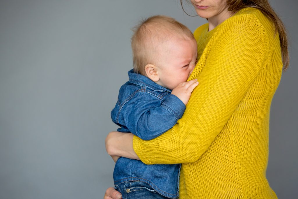 baby crying into mom's chest